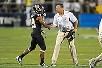 1 September 2011:  FIU Head Football Coach Mario Cristobal congratulates defensive back Sam Miller (39) after a big play in the second half as the FIU Golden Panthers defeated the University of North Texas, 41-16, at University Park Stadium in Miami, Florida.
