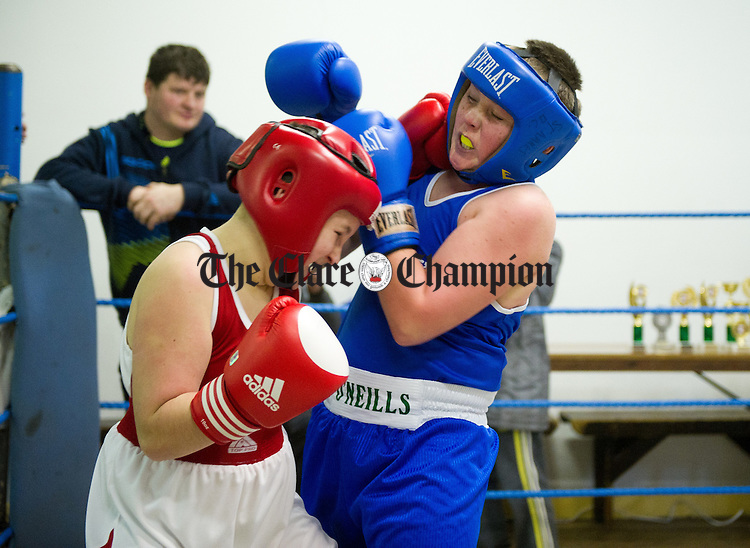 John Sweeney of Ennis in action against Eoin Mc Donagh, Westport annual Westport V Ennis boxing tournament at Ennis Boxing Club. Photograph by John Kelly.