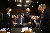 """Director Daniel Coats, Office of the Director of National Intelligence (ODNI), center, shakes hands with United States Senator Richard Burr (Democrat of Nort Carolina), right, before giving testimony before the United States Senate Select Committee on Intelligence during an open hearing on """"Worldwide Threats"""" on Capitol Hill in Washington, DC on Tuesday, January 29, 2019.  at left is Director Gina Haspel, Central Intelligence Agency (CIA).<br /> Credit: Martin H. Simon / CNP"""