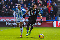 Crystal Palace's midfielder Luka Milivojevic (4) holds off Huddersfield Town's forward Collin Quaner (23) during the EPL - Premier League match between Huddersfield Town and Crystal Palace at the John Smith's Stadium, Huddersfield, England on 17 March 2018. Photo by Stephen Buckley / PRiME Media Images.