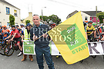 Local Postman Jimmy Dunne waves the flag to start stage 8 of An Rás 2017. Photo:Colin Bell/pressphotos.ie