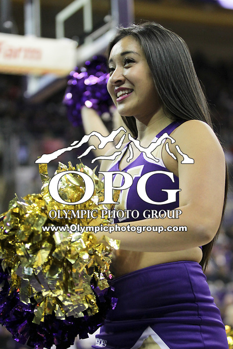 SEATTLE, WA - DECEMBER 18: Washington cheerleader Maggie Clarke entertained fans during a timeout break against Western Michigan.  Washington won 92-86 over Western Michigan at Alaska Airlines Arena in Seattle, WA.
