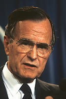 ***FILE PHOTO*** George H.W. Bush Has Passed Away<br /> Washington DC., USA,  1989<br /> President George  H.W. Bush at microphone during news. conference. <br /> CAP/MPI/MRN<br /> &copy;MRN/MPI/Capital Pictures