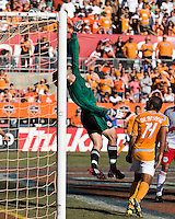 New York Red Bulls goalkeeper Danny Cepero (1) tips the ball over the net.  New York Red Bulls defeated Houston Dynamo 3-0 for an aggregate  score of 4-1 over Houston Dynamo   at Robertson Stadium in Houston, TX on November 9, 2008 in the second leg of the Western Conference semifinals.  Photo by Wendy Larsen/isiphotos.com