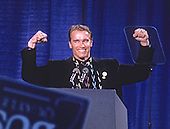 Actor Arnold Schwarzenegger shows his muscle as he speaks at a campaign rally for the Bush / Quayle '92 ticket at the Pinkerton Academy in Derry, New Hampshire on February 16, 1992 prior to the 1992 New Hampshire Primary.<br /> Credit: Ron Sachs / CNP