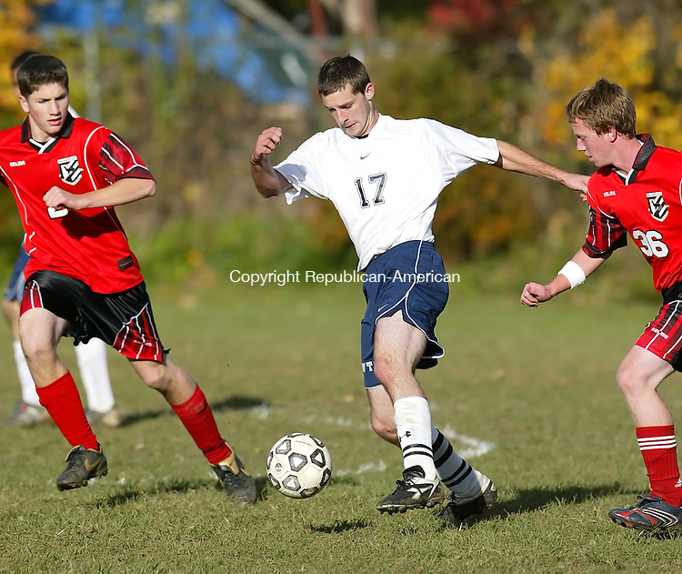 TORRINGTON, CT,  26 OCTOBER 2006, 102606BZ07-  Oliver Wolcott Tech's Chris Crusius (17) splits Northwestern's Conor Deasy (2), and  Ben Hinman (36)<br /> during their game Thursday afternoon.<br /> Jamison C. Bazinet Republican-American