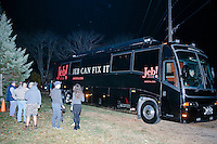 Media gather outside Republican presidential candidate and former Florida governor Jeb Bush's campaign bus after he spoke to a crowd in the barn of Dr. and Mrs. James Betti in Rye, New Hampshire, for former Massachusetts senator Scott Brown's No B.S. BBQ series.