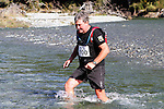 NELSON LAKES, NEW ZEALAND - APRIL 18:  Phil Downes crosses the Travers River during the 2015 Alpine Lodge Loop The Lake trail run at Lake Rotoiti on April 18 16, 2015 in Nelson, New Zealand. (Photo by Marc Palmano/Shuttersport Limited)