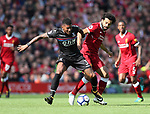 Liverpool's Mohamed Salah tussles with Crystal Palace's Patrick Van Aanholt during the premier league match at the Anfield Stadium, Liverpool. Picture date 19th August 2017. Picture credit should read: David Klein/Sportimage