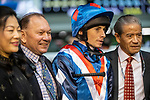 Happy Valley, Hong Kong - December 4: Flying Genius, Ryan Moore With Gary Moore and Tony Cruze after winning the Longines International Jockey' Championship Handicap First leg at Happy Valley Racecourse in Hong Kong. Michael McInally/Eclipse Sportswire/CSM