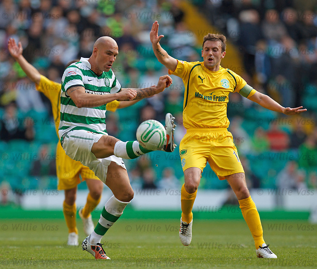 Celtic's Daniel Majstorovic steals the ball away from Kevin McBride of Hibs