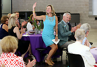 NWA Democrat-Gazette/DAVID GOTTSCHALK   Laura Underwood, a 2017 Fayetteville Schools Hall of Honor inductee, raises her hand to be acknowledged Thursday, August 10, 2017, during the formal announcement of the 21st Annual Hall of Honor Inductees at Fayetteville High School. The announcement of the inductees by the Fayetteville Public Education Foundation also included 2017 inductee Kathleen DuVal and Martha McNair.