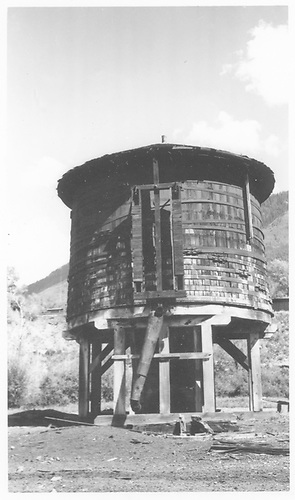 West-side view of the Rico water tank - post abandonment.<br /> RGS  Rico, CO  Taken by Maxwell, John W. - 9/4/1960