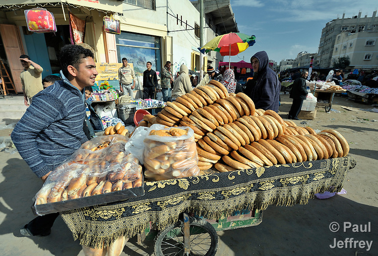 A man sells fresh bread in the market of the Nuseirat refugee camp in the middle of the Gaza strip. .