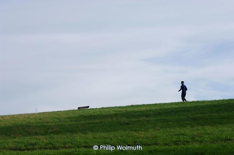 A jogger on Parliament Hill,  Hampstead Heath, London.