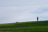 A jogger on Parliament Hill,  Hampstead Heath, London.