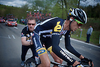 Johann Van Zyl (SAF/MTN-Qhubeka) stops at the top of the 1st climb, the C&ocirc;te de La Roche-en-Ardenne (2900m/5.6%), because of a mechanical where a team car is posted for such occasions. The staffer immediately jumps into action to set him on his way asap.<br /> <br /> 101th Li&egrave;ge-Bastogne-Li&egrave;ge 2015