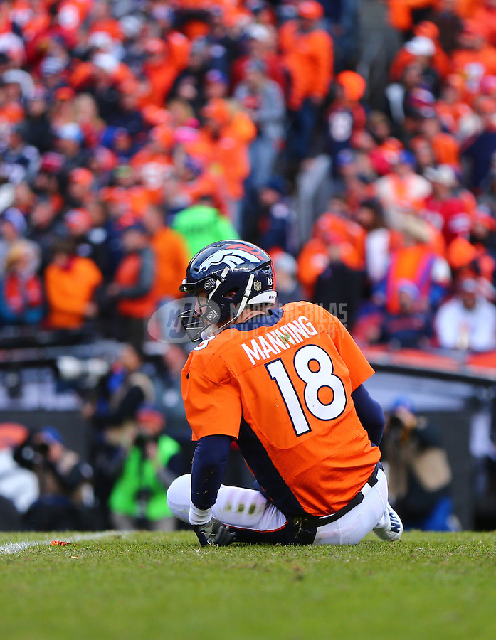 Jan 24, 2016; Denver, CO, USA; Denver Broncos quarterback Peyton Manning (18) on the ground after being tackled against the New England Patriots in the AFC Championship football game at Sports Authority Field at Mile High. The Broncos defeated the Patriots 20-18 to advance to the Super Bowl. Mandatory Credit: Mark J. Rebilas-USA TODAY Sports