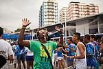 Residents of Madureira neighborhood rehearsal their samba dance in preparation for Carnaval, in Rio de Janeiro, Brazil, on Sunday, Jan 13, 2013.