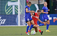 Portland, OR - Saturday July 30, 2016: Emily Menges, Nahomi Kawasumi during a regular season National Women's Soccer League (NWSL) match between the Portland Thorns FC and Seattle Reign FC at Providence Park.