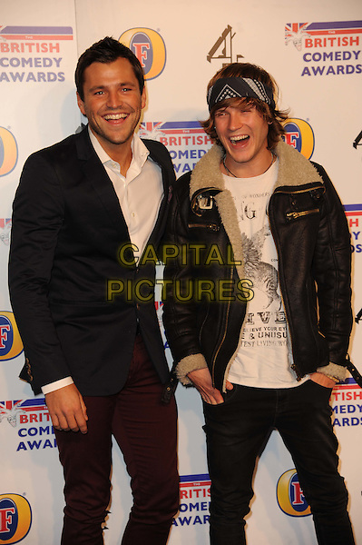 Mark Wright and Dougie Poynter.arriving at the British Comedy Awards 2011 at the Fountain Studio's, Wembley, London, UK, 16th December 2011..arrivals half length white shirt sheepskin aviator leather jacket red trousers t-shirt head scarf bandana .CAP/CAS.©Bob Cass/Capital Pictures.