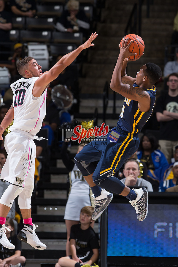 Diante Baldwin (20) of the UNCG Spartans shoots over Mitchell Wilbekin (10) of the Wake Forest Demon Deacons during second half action at the LJVM Coliseum on December 15, 2015 in Winston-Salem, North Carolina.  The Demon Deacons defeated the Spartans 81-71.  (Brian Westerholt/Sports On Film)