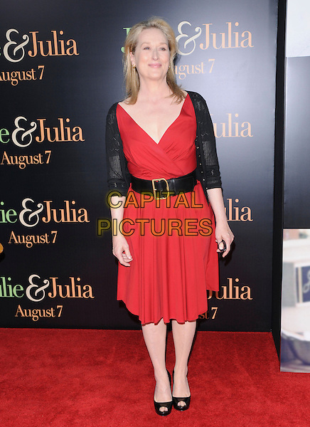 "MERYL STREEP .at The Columbia Pictures' Screening of  ""Julie & Julia"" held at The Mann's Village Theatre in Westwood, California, USA, July 27th 2009.                                                                   .full length red dress wrap black waist belt cardigan peep toe shoes heels .CAP/DVS.©DVS/RockinExposures/Capital Pictures"