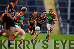 Pat McCarthy Austin Stacks in action against Martin Burke Mid Kerry in the Kerry Senior County Football Final at Fitzgerald Stadium on Sunday.