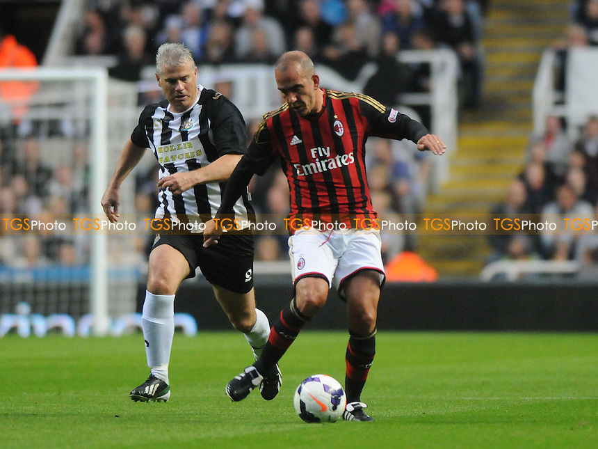 Paolo Di Canio of AC Milan Glorie battles with Rob Lee of Newcastle United Legends - Newcastle United Legends vs AC Milan Glorie - Steve Harper Testimonial Match at Newcastle United FC, St James Park, Newcastle upon Tyne - 11/09/13 - MANDATORY CREDIT: Steven White/TGSPHOTO - Self billing applies where appropriate - 0845 094 6026 - contact@tgsphoto.co.uk - NO UNPAID USE