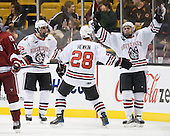 Rob Dongara (Northeastern - 39), Mike Hewkin (Northeastern - 28) and Mike McLaughlin (Northeastern - 18) celebrate McLaughlin's goal. - The Northeastern University Huskies defeated the Harvard University Crimson 4-0 in their Beanpot opener on Monday, February 7, 2011, at TD Garden in Boston, Massachusetts.