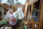 A woman picks up the pieces after hurricane Kate took her roof and destroyed her home in Apalachicola, Florida November 21, 1985.  Kate, a late November Hurricane,  was latest forming Atlantic hurricane on record at the time and was the second for the area following Hurricane Elena two months earlier.