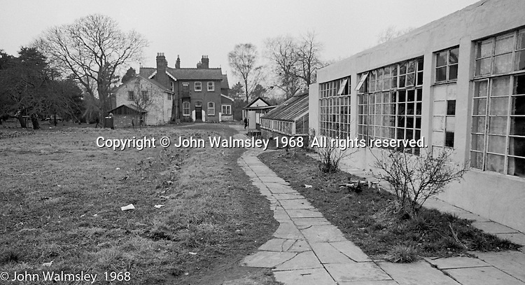 """Looking passed the """"San"""" (used to be a sanitorium) towards the main building, Summerhill school, Leiston, Suffolk, UK. 1968."""