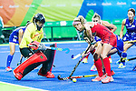 Kathleen Sharkey #24 of United States trying to find a way past Sakiyo Asano #1 of Japan during USA vs Japan in a Pool B game at the Rio 2016 Olympics at the Olympic Hockey Centre in Rio de Janeiro, Brazil.