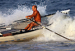 Jeff Propert of Bradley Beach turns his boat through a wave during the 3,000-meter surfboat event at the First Annual Asbury Park Beach Bar Lifeguard Competition held at the 3rd Avenue beach in Asbury Park.  ASBURY PARK, NJ  8/4/07  8:21:47 PM  PHOTO BY ANDREW MILLS.