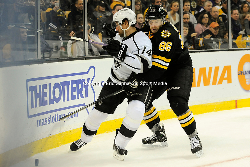 January 20, 2014 - Boston, Massachusetts, U.S. - Boston Bruins defenseman Kevan Miller (86) and Los Angeles Kings right wing Justin Williams (14) battle for the puck  during the NHL game between Los Angeles Kings and the Boston Bruins held at TD Garden in Boston Massachusetts. The Bruins defeated the Kings 3-2 in regulation time.   Eric Canha/CSM