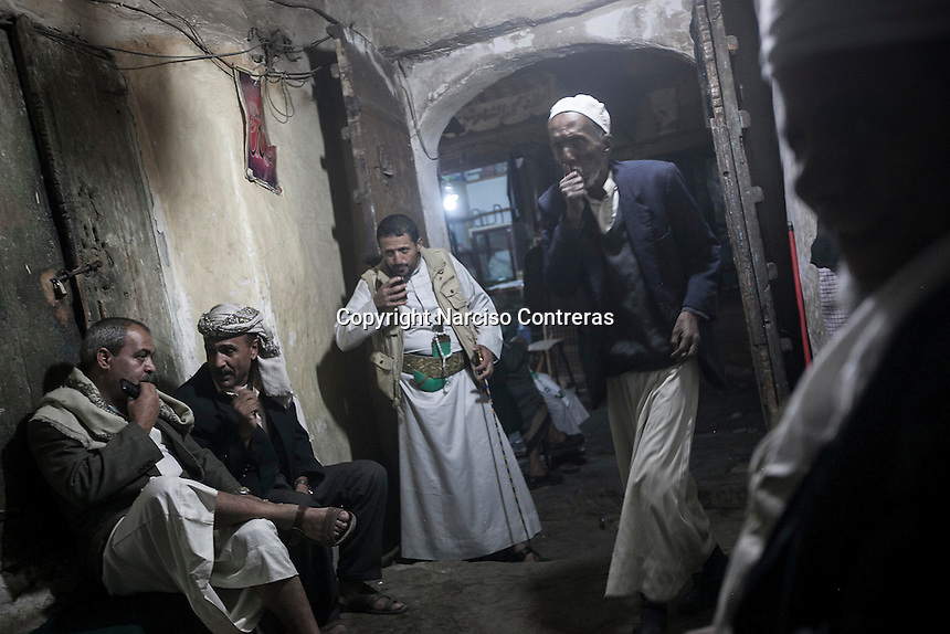 Sunday 12 July, 2015: An old-fashioned coffee shop is attended by regular customers in the Old City of Sana'a, a 2,500-year-old cultural heritage site endangered after a fighter jet of the Saudi-led coalition bombed and destroyed a line of residential tower-houses killing 4 residents and reducing to rubble the historial site. The ongoing aerial campaign of bombardments by the Arab states and their western allies led by Saudi Arabia and the heavy fighting against the entrenchment of the Houthi insurgency along the Yemeni main cities from north to south has caused an international alert for the enlisted cultural heritage sites in Yemen, such as the historic town of Zabid, the Old City of Sana'a and the Old Walled City of Shibam. (Photo/Narciso Contreras)