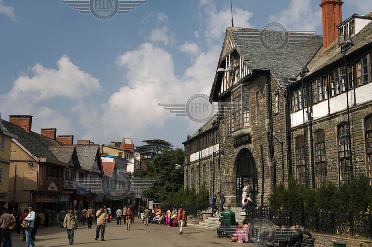 A view down a street in Shimla, showing buildings which are reminiscent of some English architecture.