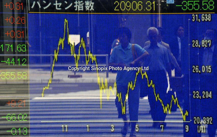 Businessmen are reflected in a Stock Exchange Screen board at Otamachi in Tokyo. Stocks fell in Japan after the surprise resignation of Japanese Prime Minister Yasuo Fukuda,  September 1st, 2008...