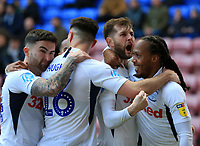 8th February 2020; DW Stadium, Wigan, Greater Manchester, Lancashire, England; English Championship Football, Wigan Athletic versus Preston North End; Tom Barkhuizen of Preston North End  celebrates with his team maters after scoring to give his side a 0-1 lead after 7 minutes
