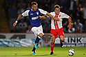 Luke Chambers of Ipswich battles with Luke Freeman of Stevenage<br />  Stevenage v Ipswich Town - Capital One Cup First Round - Lamex Stadium, Stevenage - 6th August, 2013<br />  © Kevin Coleman 2013