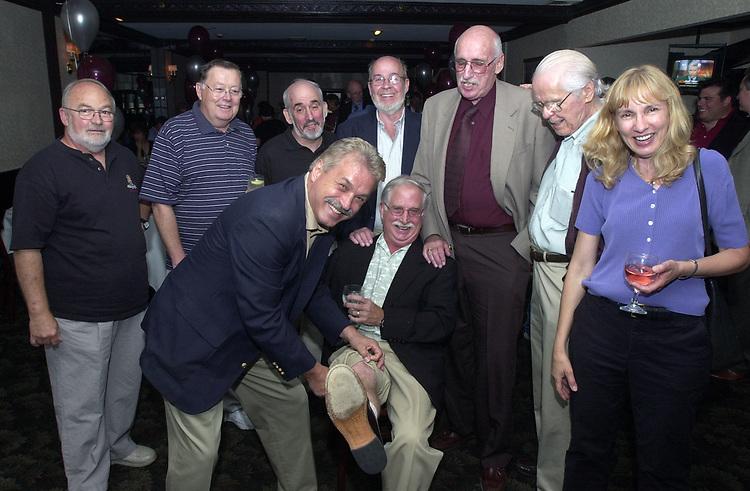 Joe Dombroski, Bob Luckey, Stan Wolfson, Don Norkett, Dick Kraus, Karen Wiles and Tom Maguire seen gathered around John Cornell at his retirement party on October 10, 2000. Photo by Jim Peppler. Copyright/Jim Peppler-2000