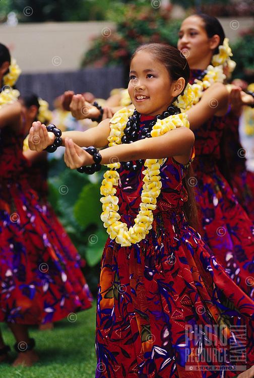Halau Hula O Hokulani performing for a Lei Day Celebration on the lawn at the Hilton Hawaiian Village