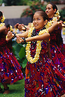 Halau Hula O Hokulani performing for a Lei Day Celebration on the lawn at the Hilton Hawaiian Village