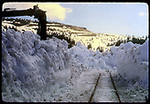 View of partly plowed track at Cumbres. Snow appears to be 6 feet deep or more.<br /> D&amp;RGW  Cumbres, CO