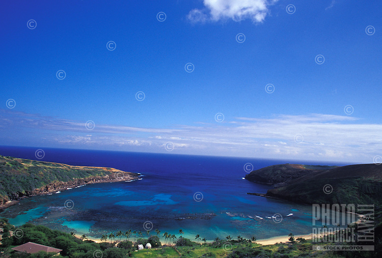 White sand beach and clear blue water over reef, seen from above Hanauma Bay, Oahu, Hawaii