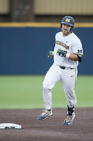Michigan Wolverines catcher Harrison Wenson (7) jogs around the bases after hitting a home run against the Michigan State Spartans on May 19, 2017 at Ray Fisher Stadium in Ann Arbor, Michigan. Michigan defeated Michigan State 11-6. (Andrew Woolley/Four Seam Images)