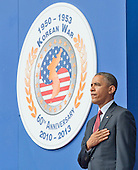 United States President Barack Obama stands at attention as the Star Spangled Banner is played prior to delivering remarks marking the 60th Anniversary of the Korean War Armistice at the Korean War Veterans Memorial in Washington, D.C. on Saturday, July 27, 2013.<br /> Credit: Ron Sachs / Pool via CNP