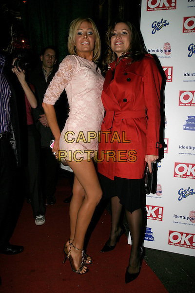 ORLAITH MCALLISTER & REBECCA LOOS.OK! Magazine VIP Christmas Karaoke Party, Papageno, London, UK..December 14th, 2005.Ref: AH.full length with together pink lace mini dress red mac trench coat jacket laughing smiling.www.capitalpictures.com.sales@capitalpictures.com.©Capital Pictures.