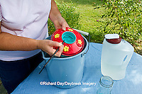 01162-12717 Woman cleaning hummingbird feeder, Marion County, IL
