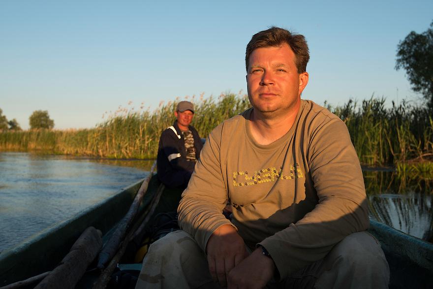 Christian Mititelu and fisherman Florin Moisa on asssignment with Magnus Lundgren in Danube Delta, Romania